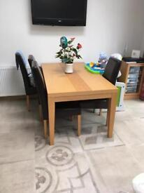 Oak dining table and 6ml toughened glass cover (chairs not included)