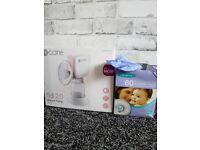 Electric breast pump. Great working. Free nursing pads