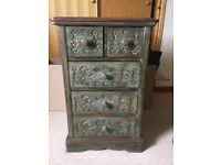 Unusual hand carved small set of drawers