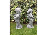 Boy and girl concrete garden ornaments