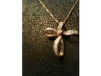 DIAMOND set Bow style cross necklace.