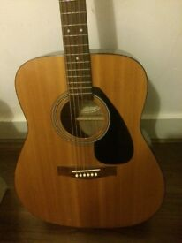 Yamaha f310 acoustic guitar with electronic tuner and capo. Fair condition