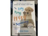 Puppy bag & rain jacket & book