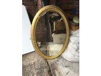Large oval plaster mirror has a bit of damage around the edge see pictures