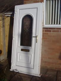 White pvc door and frame with glass feature panel and brass handles