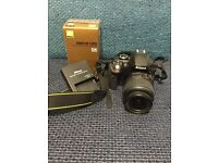 Black Nikon D3300 Camera with lense and charger
