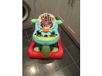 Baby walker, animal print wipe able seat, with musical foot bar and table with cup hole.