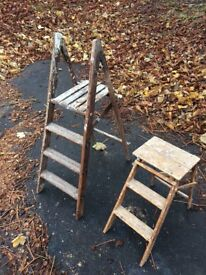 Two old step ladders