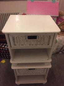 Two white and wicker bedside tables