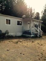 .24 acre property with 1130 sq ft mobile home