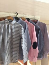 A mixture of designer and smart casual shirts and shorts