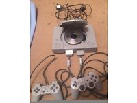 Selling Sony Playstation 1 with two controllers, memory card and Tekken 3