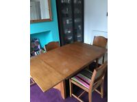 Extended dining table and 4 chairs