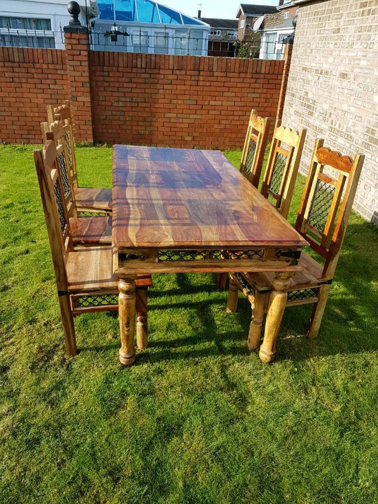 Solid Hardwood Table and six 6 Chairs.