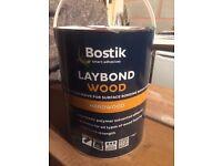 Bostik hardwood floor glue,left over from laying a floor.full unopened 7 kg tin.