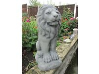 PAIR OF RUSTIC CONCRETE STONE LION STATUES