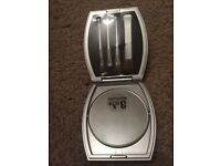 Mirror compact and brushes