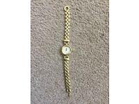 Gold colour chain female watch