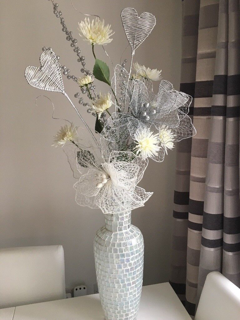 Large vase with artificial flowers