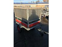 trailer with high caged frame