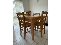 Extendable Dining table and 4 chairs.