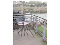 Spacious one bedroom apartment with water views at Victoria Wharf