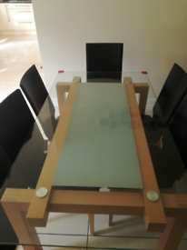 Frosted glass and wooden table with matching leather chairs