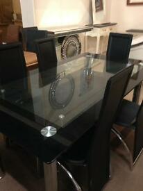 Glass table and six chairs set£280