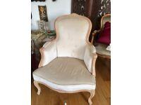 Beige antique armchair