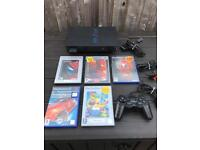 PlayStation 2 console and games. Ps2