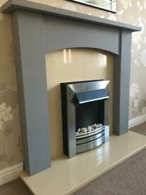 Electric fire with marble hearth and back plate and grey surround