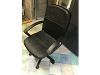 Black leather look office chair with arms on castors and adjustable