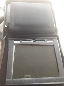 Dvd player with 10 inch display and in its own case.