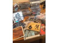 Approximately 100 various cds