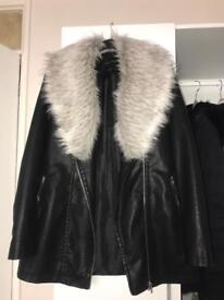 Women's black leather jacket with fur