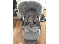 My babie travel system with fur trim , car seat , carrycot & rain covers
