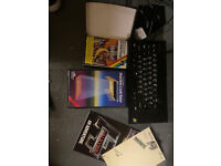 ZX Spectrum+ with power adapter, games and cassette player