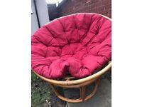 The Pier Papasan moon round wicker chair red cushion