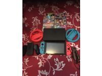 Nintendo switch neon with 1-2 switch and MARIO kart 8 deluxe