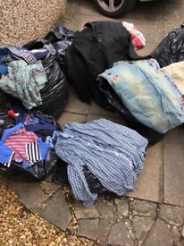 Large bundle of assorted clothing