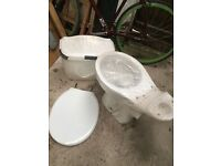 New porcelain toilet and seat