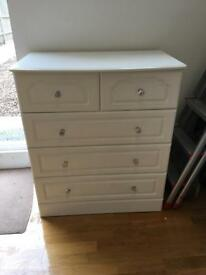 White chest of drawers and 2 bedside tables