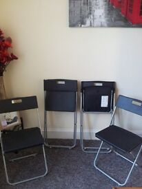 BLACK X 4 FOLD CHAIRS AS NEW