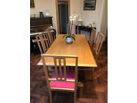 Beautiful dining table and chairs in solid Chinese oak