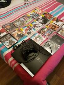 Playstation 3 with 20 games for sale