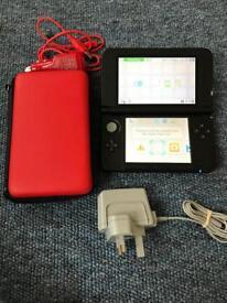 Nintendo 3DS XL + 8 games inc Mario kart