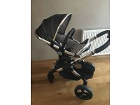 Immaculate Peach chassis and truffle seat and carrycot
