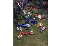 Bundle of children's balance bikes and scooters