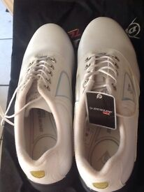 New size 7 Dunlop ladies golf shoes still in bag
