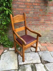 Oak carver chair with burgundy leather seat